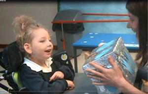 Figure 1b. The pupil's delight at being offered her 'smile box'.
